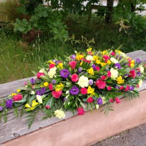 bright flower spray-double ended casket spray-funeral flowers-florist-torbay