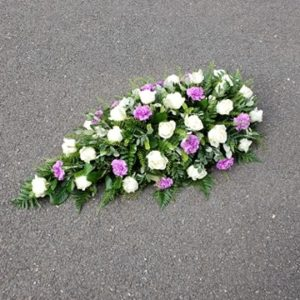 single ended rose and carnation coffin spray-funeral flowers- florist